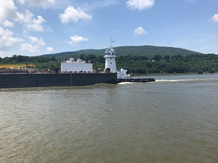 tanker being pushed down the river