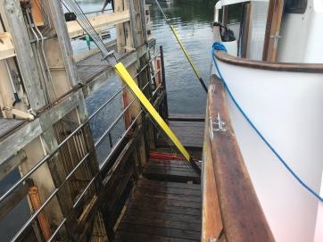 slings holding boat